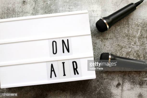 on air sign and microphones - radio broadcasting stock pictures, royalty-free photos & images