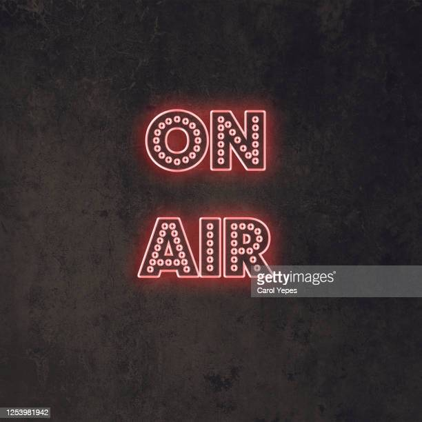 on air sign in neon red lights with black background - radio stock pictures, royalty-free photos & images