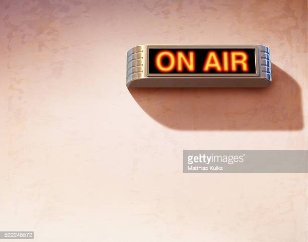'On air' sign on wall