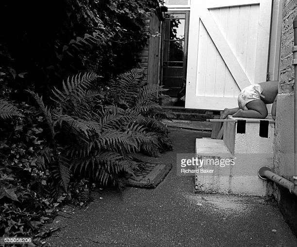 On all fours An eleven monthold infant crawls up some back garden steps and into her parents' house Her head and shoulders are already hidden as she...