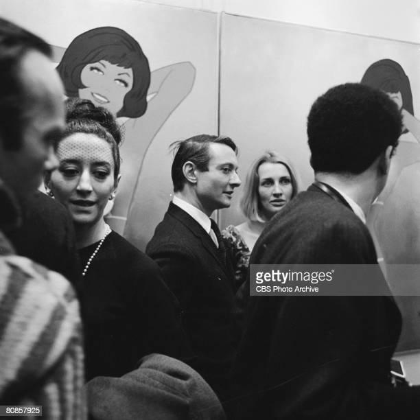 On an episode of the television documentary news program 'Eye on New York' American artist Roy Lichtenstein attends the 'First International Girlie...