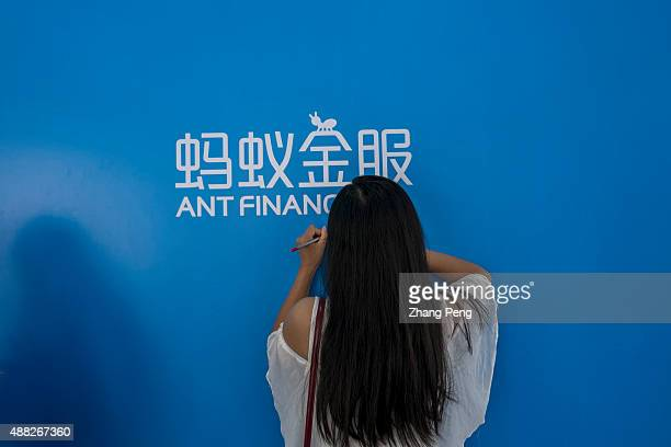 On an exhibition a girl is filling a form to become a costumer of Ant Financial In August Alibabas Ant Financial has just launched an integrated...