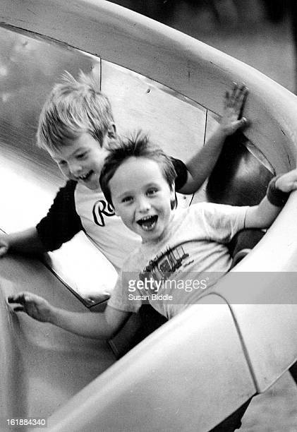 OCT 29 1986 On an outing to Washington Park with their class Mike Leimkuhler and Andy Fowler used the playground slide They are students at St John's...
