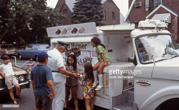 On an unspecified residential street a 'Good Humor' man sells ice cream to a group of children Queens New York New York July 1 1970