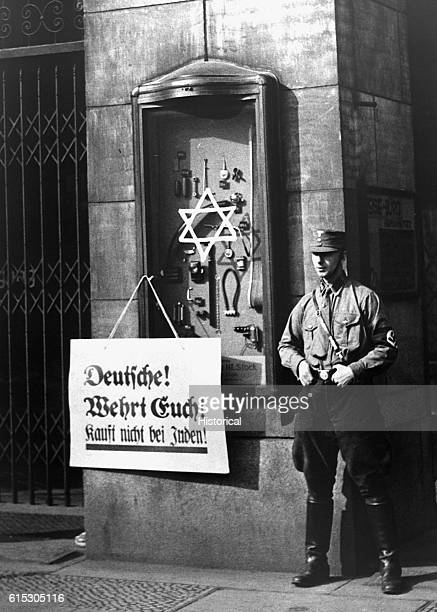 On April 1 the boycott announced by the National Socialist party began Placard reads Germans defend yourselves do not buy from Jews at the Jewish...