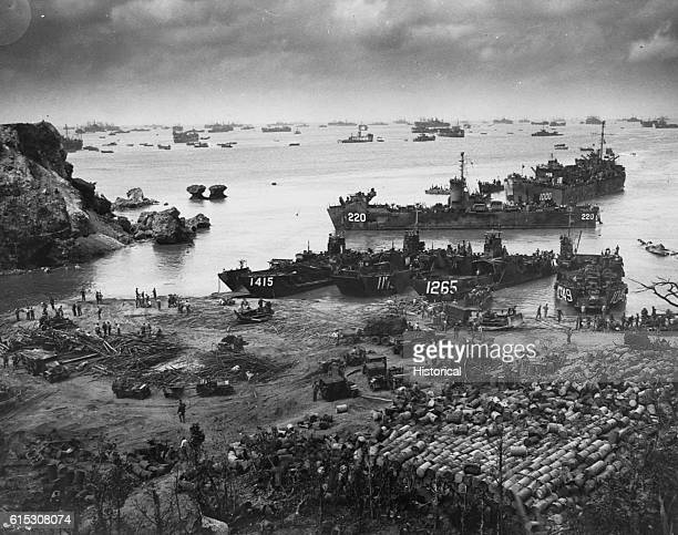 On April 13 a formidable task force carves out a beachhead about 350 miles from the Japanese mainland at Okinawa. Landing craft of all kinds fill the...