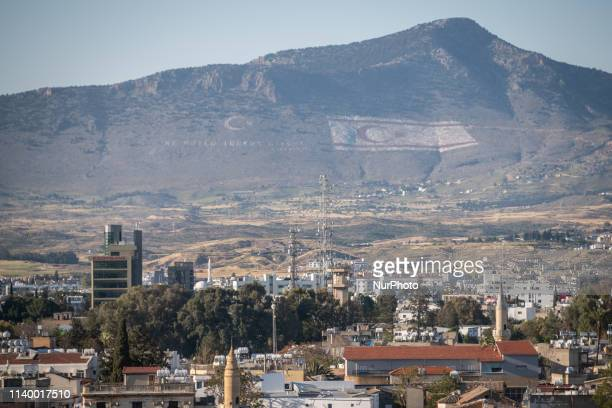 On April 22 2019 the Turkish flag and the Turkish Cypriot flag are visible on a mountain near the capital city of Cyprus Nicosia or Lefkosa in...