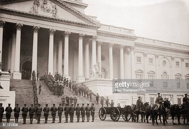 On Armistice Day pallbearers carry the coffin of the 'Unknown Soldier' of World War I down the steps of the Capitol in Washington DC to the gun...