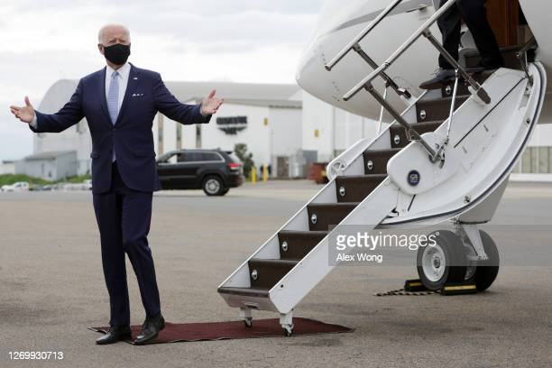 Democratic presidential candidate former Vice President Joe Biden gestures after he landed at Allegheny County Airport on August 31 2020 in West...