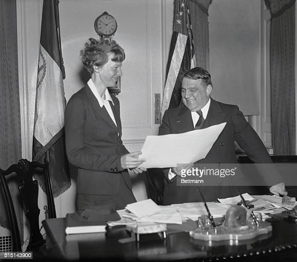 """On behalf of the city of New York, Mayor F.H. LaGuardia is pictured presenting a certificate """"for distinguished and exceptional public service"""" in..."""