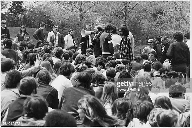 On Blanket Hill Kent State University faculty use a microphone to try and convince antiwar demonstrators and students to disperse after the Ohio...
