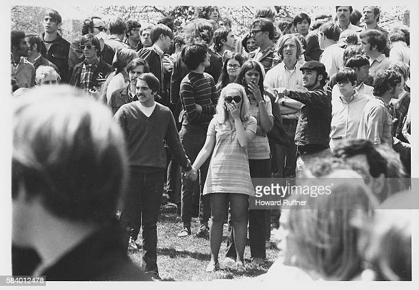 On Blanket Hill Kent State University students several with hands over their mouths stare in the aftermath of the Ohio National Guard having opened...