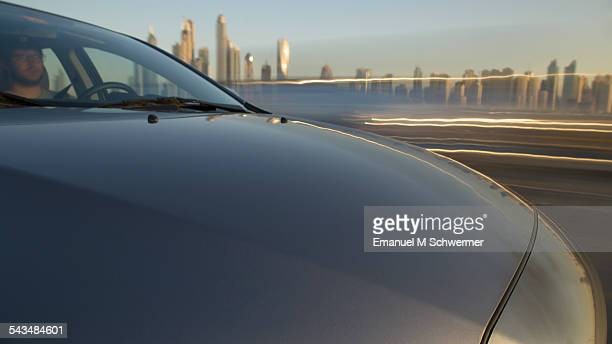on board a driving car - hood in foreground