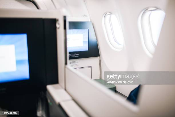 on board entertainment tv screens on business class of airplane - 乗り物に乗って ストックフォトと画像