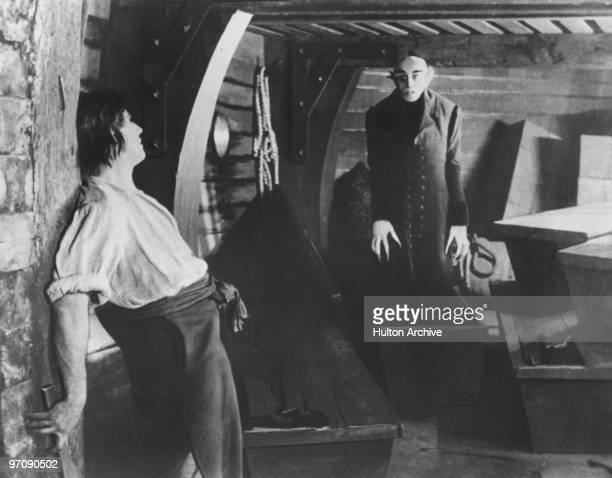 On board the Demeter the vampire Count Orlok played by German actor Max Schreck emerges from one of his coffins before they can be destroyed by the...
