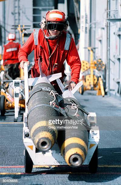 On board the nuclear powered aircraft carrier USS George Washington Sergeant John Hyatt from New York Penn transporting ordnance to a waiting F/A18C...