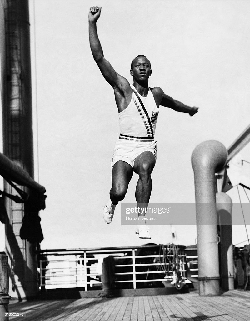 On board the S. S. Manhattan on the way to the 1936 Olympics in Berlin with the rest of the American team, Jesse Owens practises the long jump on the deck. Owens is the long jump world record holder and a hope for the Olympic gold medal. | Location: S. S. Manhattan.