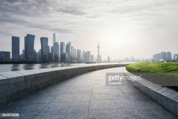On both sides of the bund in Shanghai cityscape.