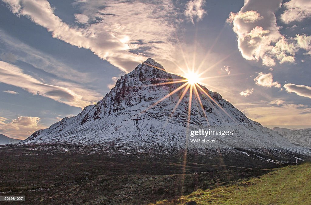 on Buachaille Etive Mor with sunburst, Glencoe : Stock Photo