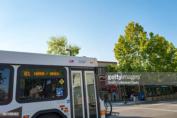 On Castro Street in the downtown portion of the Silicon Valley town of Mountain View California a bus passes by with a sign indicating that it is...