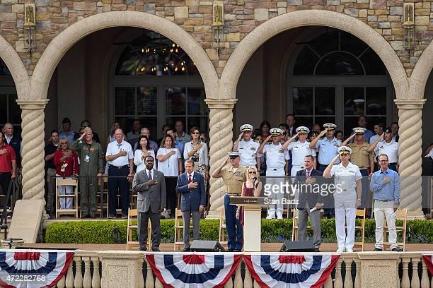 On center stage from left Jacksonville Mayor Alvin Brown PGA TOUR Commissioner Tim Finchem Sergeant Major Bryan Battaglia recording artist Cali Rodi...