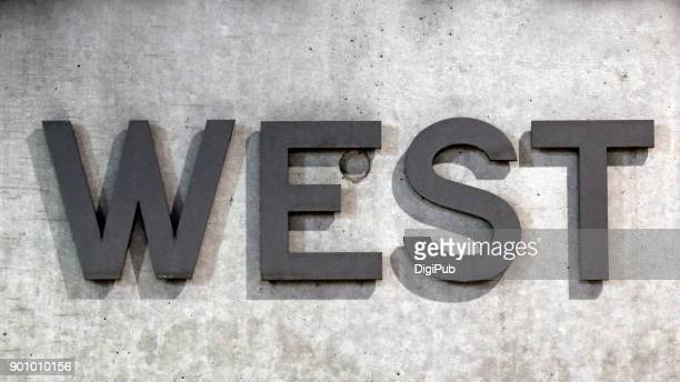 'WEST' on concrete wall