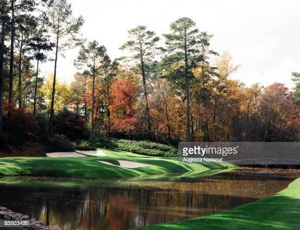 On course view of the 12th green with the Byron Nelson Bridge in the background in the Fall season at the Augusta National Golf Club in Augusta,...