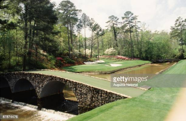 On course view of the Ben Hogan Bridge with the 12th green in the background during the 1989 Masters Tournament at Augusta National Golf Club in...
