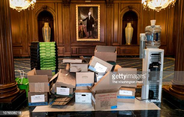 On day 11 of the partial government shutdown Capitol workers place Republican Majority Leader Kevin McCarthy's office items in the Rayburn Room just...