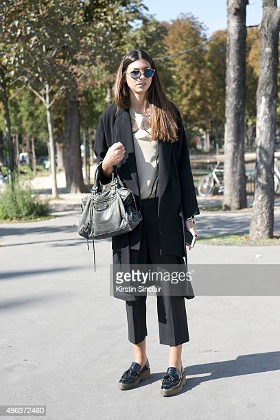 on day 5 during Fashion Buyer Myrto Leandrou wears a One on One top and trousers Zara jacket and shoes Balenciaga bag and sunglasses from Milan Paris...