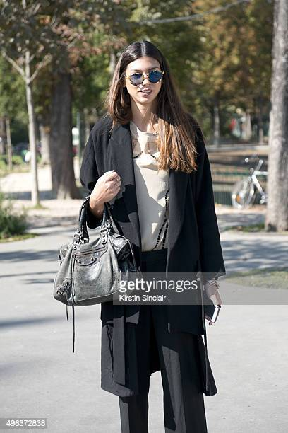 on day 5 during Fashion Buyer Myrto Leandrou wears a One on One top and trousers Zara jacket Balenciaga bag and sunglasses from Milan on day 5 during...