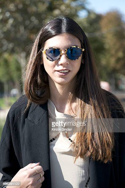 on day 5 during Fashion Buyer Myrto Leandrou wears a One on One top Zara jacket and Balenciaga sunglasses from Milan on day 5 during Paris Fashion...