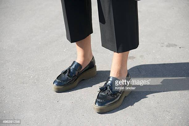 on day 5 during Fashion Buyer Myrto Leandrou wears One on One trousers and Zara shoes on day 5 during Paris Fashion Week Spring/Summer 2016/17 on...