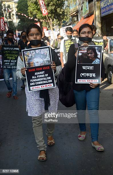 On December 17 Kolkata India Activists of All India Democratic Students' Organization participated in silent protest rally for for Tuesday's Taliban...