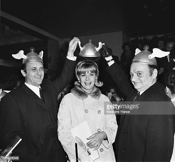 On December 20 The Scriptwriter Rene Goscinny The Announcer Jacqueline Huet And The Illustrator Albert Uderzo At The Premiere Of The Cartoon Asterix...