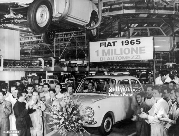 On December 21 1965 in the FIAT factories in Turin the team celebrates the 1 millionth car built in the year