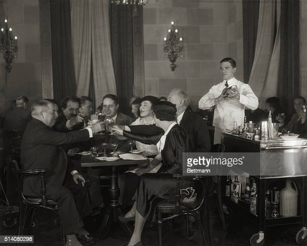 On December 4 the day before Prohibition is repealed noted artists and writers toast the return of legal alcohol in the Park Lane Hotel in New York...