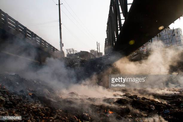 On December 9 2018 in Dhaka Bangladesh At Kamrangir Char area of the capital which is a embankment area Local people dump their garbage under the...