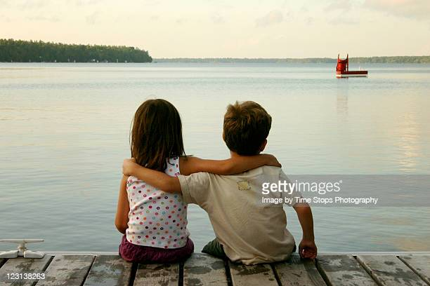 on dock - arm around stock pictures, royalty-free photos & images
