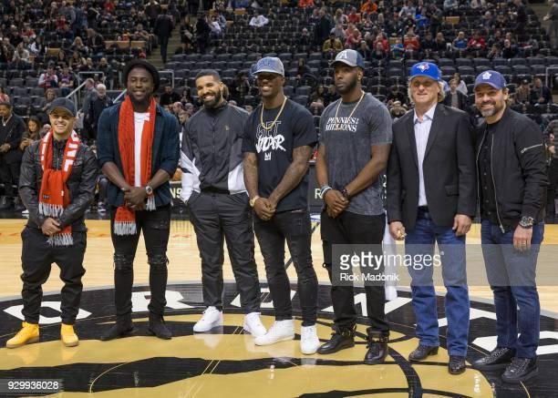 On Drake night honouring the Toronto sports teams from left Sebastian Giovinco Jose Altidor Drake James Wilder Jr SJ Green Kelly Gruber and Darcy...