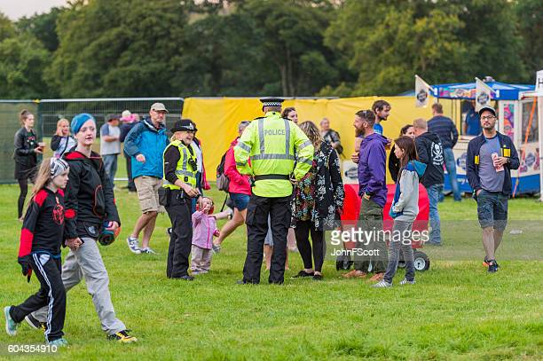 On duty Police officers and festival goers music festival