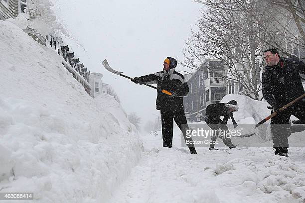 On East Sixth Street in South Boston the snow piles were getting high Helping to shovel out cars is Stephen Fiske Elizabeth Smith and Rep Nick...