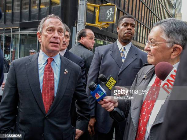 On election day, American politician New York City Mayor Michael Bloomberg speaks with journalists, at the intersection of 7th Avenue and West 53rd...