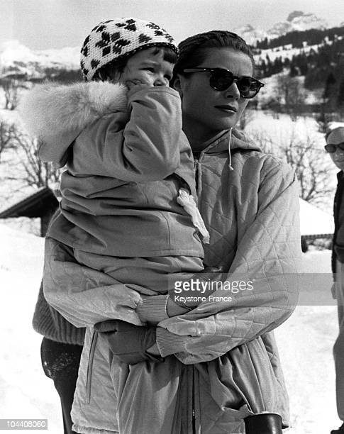 On February 25 while on vacation in Gstaad Princess GRACE of MONACO was pictured holding her daughter CAROLINE then aged 3 in her arms