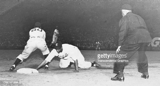 On field action during a night game in a Mexican League game, Mexico, early 1940s. Among those pictured is Cuban player Martin Dihigo .