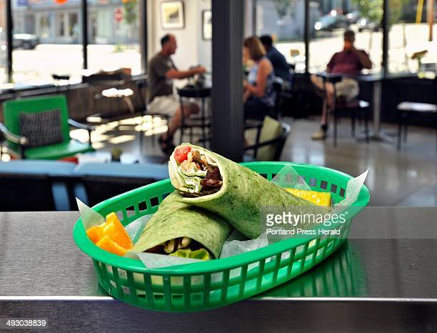 On Friday August 16 Jeannie Dunnigan owner of Cia Cafe in Knightville South Portland with her husband made a veggie rollup with fresh local produce...