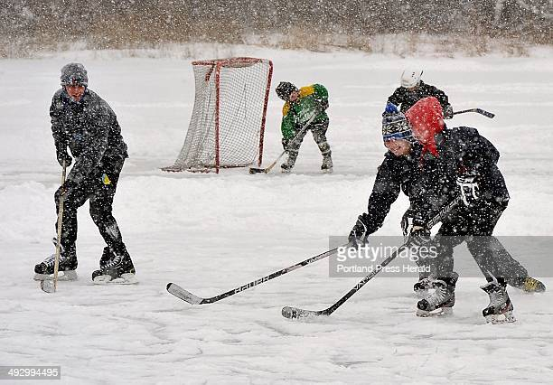 On Friday February 08 Yarmouth school kids play hockey in blizzard conditions on the Yarmouth skate pond off Main St They had no school today because...