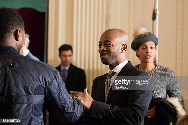 On Friday, January 6 in Washington D.C., USA , , Usher chats with Tim Witherspoon , with Usher's wife Grace Miguel heading to her seat, before First...