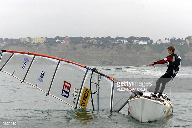 On her first trial on sea Raphaela Le Gouvello hoists her board's sail in Chorillos Bay Lima 31 July 2003 Le Gouvello will set sail 05 August from...