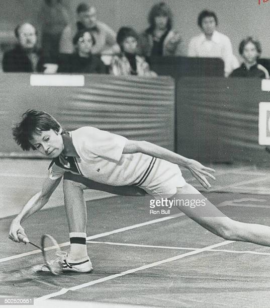 On her way to an upset Wendy Clarkson of Calgary reaches for a shot while playing Margaret Lockwood of England Saturday in the Canadian Open...